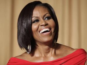 US First Lady Michelle Obama laughs at t