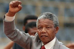 Anti-apartheid leader and African National Congress (ANC) member Nelson Mandela raises clenched fist, arriving to address mass rally, a few days after his release from jail, 25 February 1990, in the conservative Afrikaaner town of Bloemfontein, where ANC was formed 75 years ago.        (Photo credit should read TREVOR SAMSON/AFP/Getty Images)